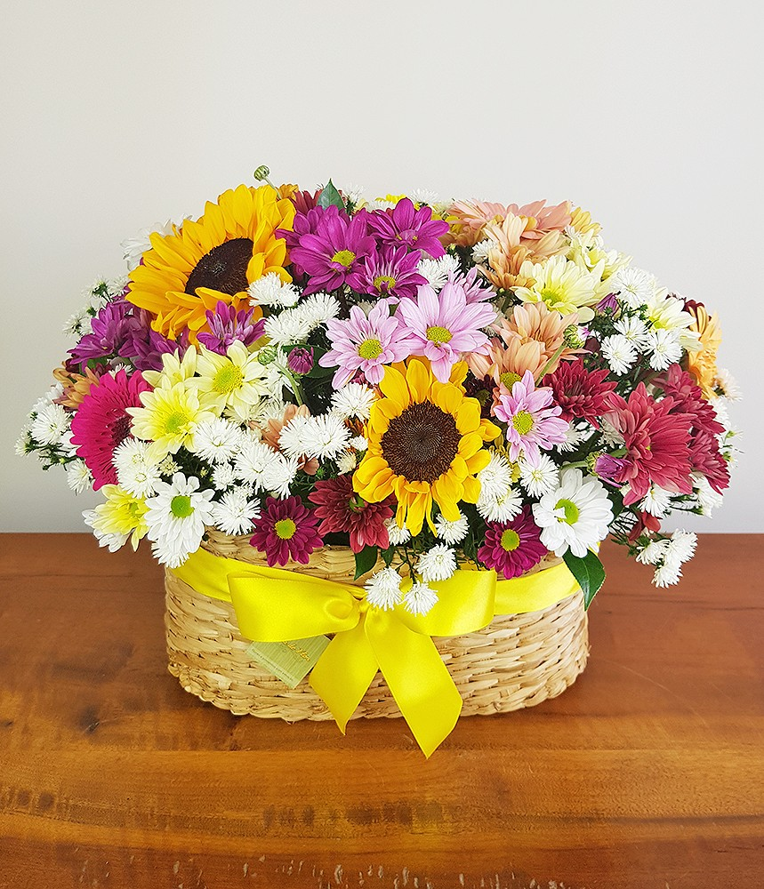 Cesta de flores campestre e girassol Colorido da Vida